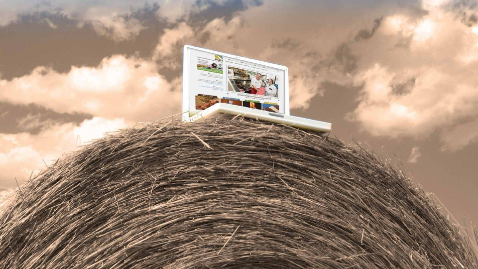 computer on top of a hay bale