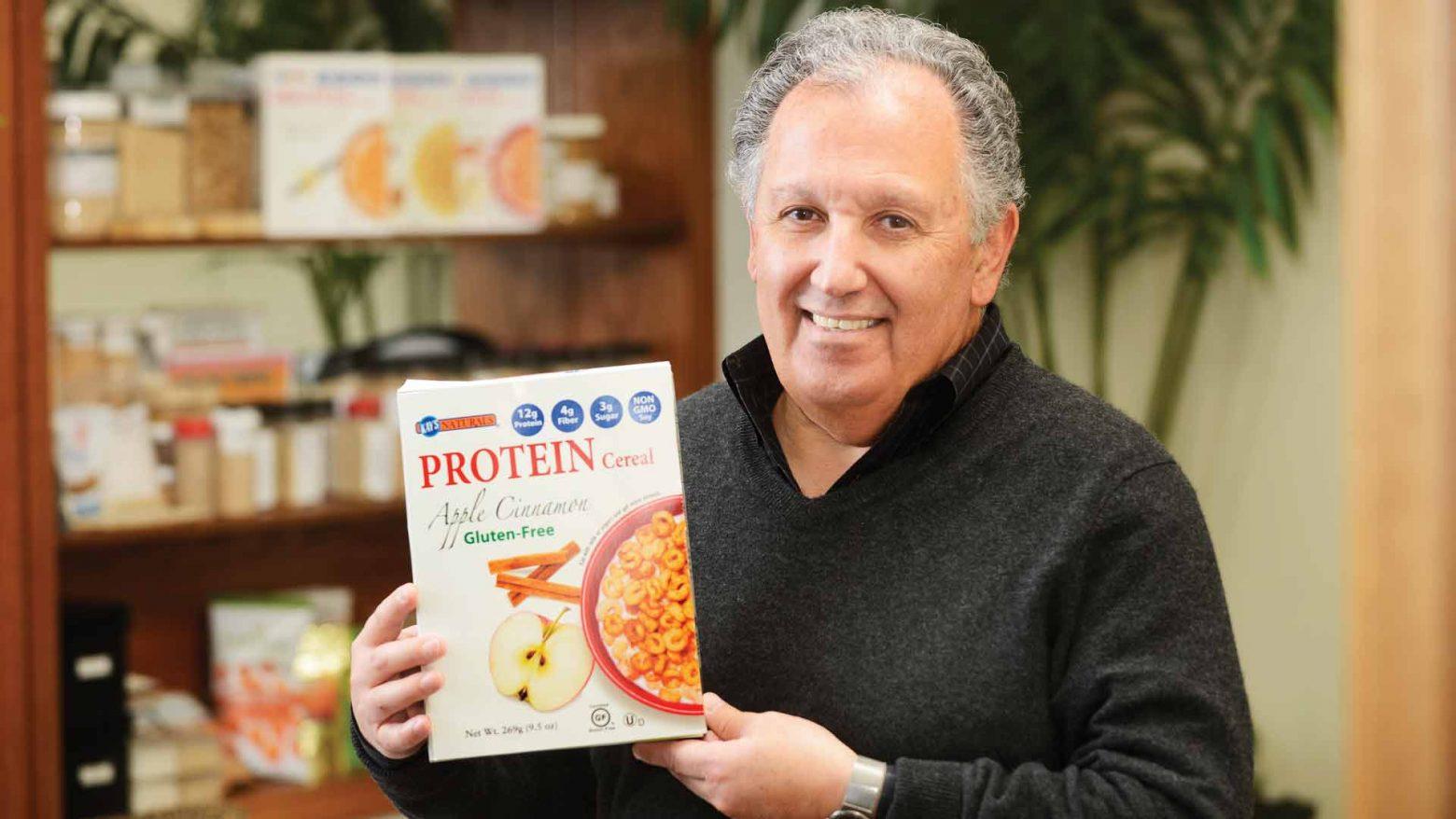 Massoud Kazemzadeh kays naturals holding box of cereal